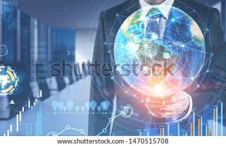 Businessman with smartphone in blurred office with double exposure of business infographics. Market analysis concept. Toned image. Elements of this image furnished by NASA #1470515708