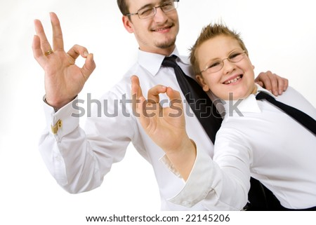 """Businessman with son making """"ok"""" signs with fingers"""