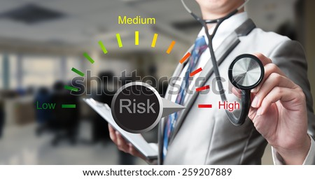 businessman with stethoscope working on risk management, business concept