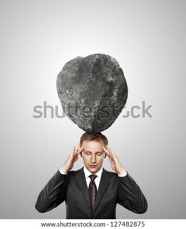 businessman with stone on his head