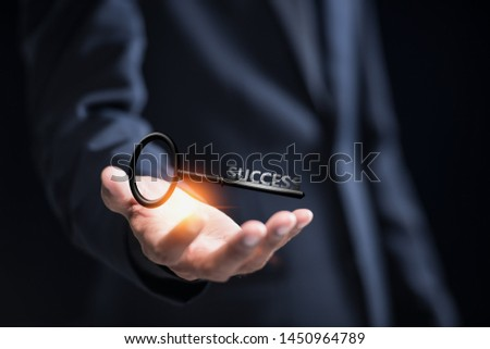 Businessman with success key, concept of successful.