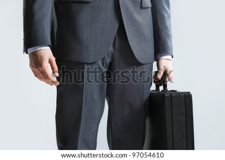 businessman with suitcase, close up