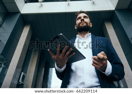 Businessman with tablet, businessman on the street, businessman thinks. #662209114