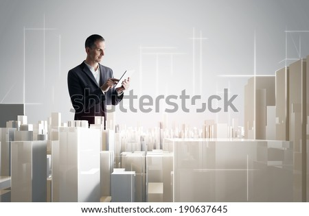 Businessman with tablet PC working with a modern city project stock photo