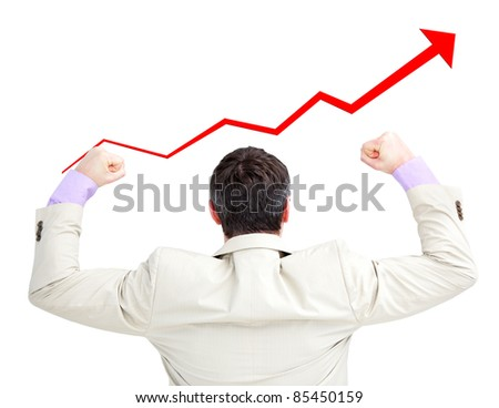 Businessman with the fists up looking at a growing curve