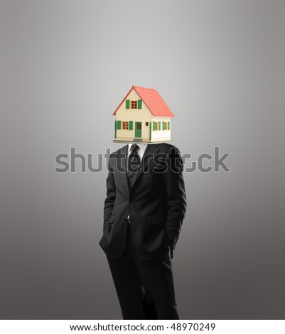 Businessman with the model of a house instead of his head