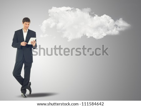 Businessman with touch screen Internet Tablet and the clouds. Maybe will used as concept cloud service