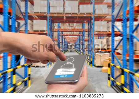 businessman with touchscreen tablet to login application for inspection checking inventory in stock room. Warehouse storage of retail merchandise shop. #1103885273