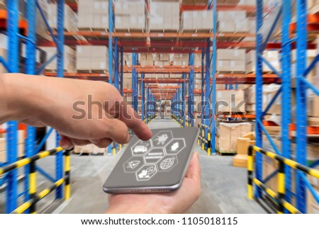 businessman with touchscreen tablet to login application for inspection checking inventory in stock room. Warehouse storage of retail merchandise shop. #1105018115