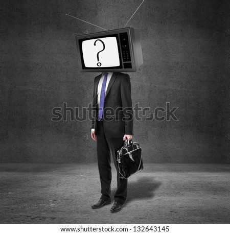 businessman with tv head on concrete room
