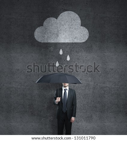 businessman with umbrella and cloud