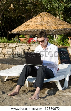 Businessman work in Laptop on the beach