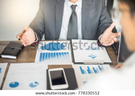 Businessman work with computer on table in office work with paper graph chart business marketing plan analysis  #778330552