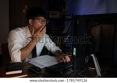 Businessman workaholic sit at the computer working late at night yawn tired and sleeping in the office,Hard work in the later time concept ストックフォト ©