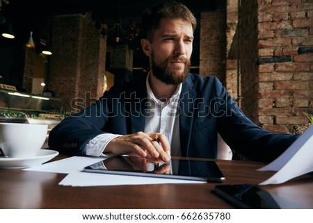 Businessman working, businessman in cafe, businessman looking at documents                                #662635780