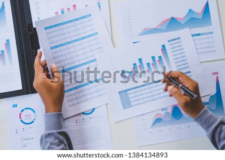 businessman working calculate data document graph chart report marketing research development  planning management strategy analysis financial accounting. Business office concept. #1384134893