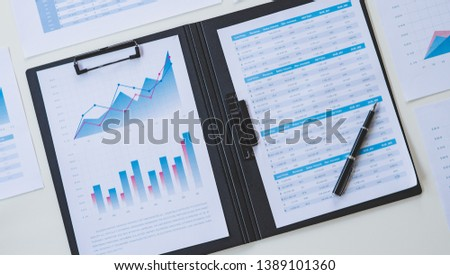businessman working calculate data document graph chart report marketing research development  planning management strategy analysis financial accounting. Business office concept. #1389101360