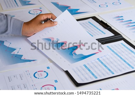 businessman working calculate data document graph chart report marketing research development  planning management strategy analysis financial accounting. Business office concept. #1494735221