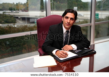Businessman working in an office dressed in a suit