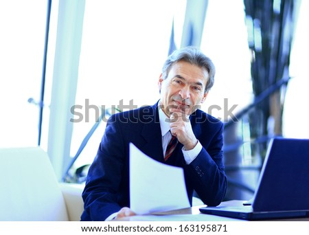 businessman working in office, sitting at desk