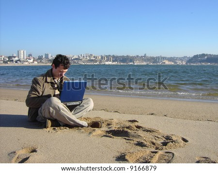 businessman working in the beach - stock photo
