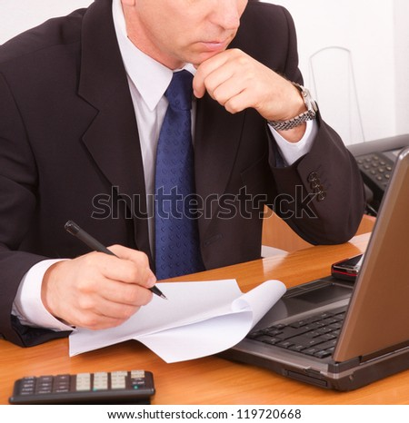 Businessman working on a laptop. close up.