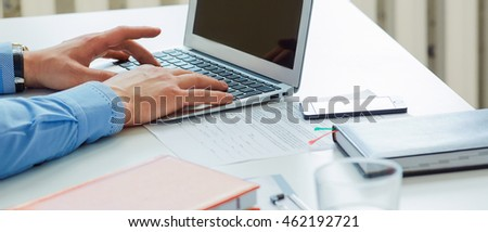 Businessman working on a laptop in the office. Serious business, exchange market, job offer, analytics research, excellent education, certified public accountant concept #462192721