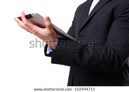 Businessman working on digital tablet in white background