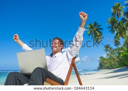 Businessman Working On Laptop at Beach #184643114