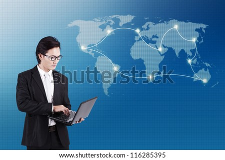 Businessman working on laptop computer standing in front of world map background and global business connectivity concept