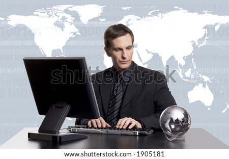 Businessman working on the computer, with an earth globe on his desk, and an earth map behind him.