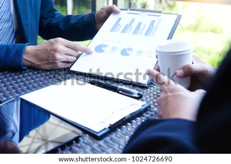 businessman working out of office near natural feeling for present business work and marketing plan with computer screen clipping path #1024726690