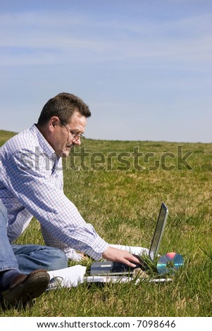 Businessman working outdoors with laptop