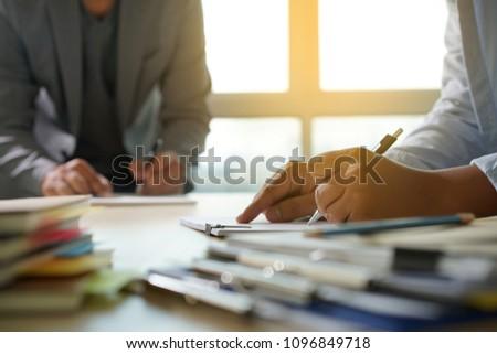 Businessman working reading documents graph financial to job succes Analyze document plans #1096849718