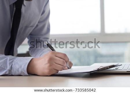 Businessman working reading documents graph financial to job succes Analyze document plans #733585042