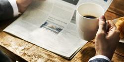 Businessman Working Reading Newspaper Information Concept