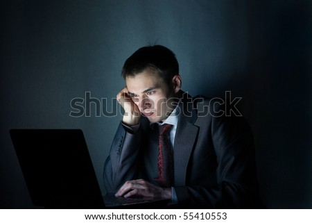 businessman working with computer at night - stock photo