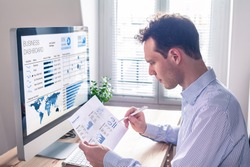 Businessman working with dashboard and key performance indicator (KPI) metrics, business intelligence (BI) graph and charts and financial report data with computer in office