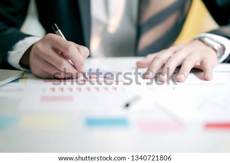 Businessman working with data document graph chart report or marketing research, development at office. Business office concep #1340721806