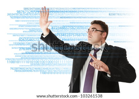 Businessman working with digital data on virtual touch screen
