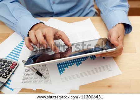 Businessman working with digital tablet.