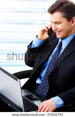 businessman  working with laptop and calling by cellular