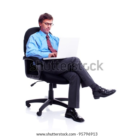 Businessman working with laptop computer. Isolated over white.