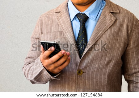 Businessman working with mobile phone
