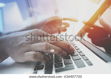 businessman working with mobile phone and digital tablet and laptop computer on wooden desk in modern office with VR icon and chart diagram #636407720