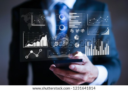 Businessman working with modern devices, Data analytics report and key performance indicators on information dashboard for Business strategy and business intelligence.