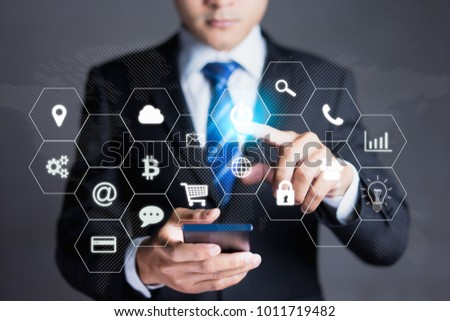 businessman working with modern devices,Internet of things - IOT and digital marketing via multi-channel communication network on mobile smart device application technology #1011719482