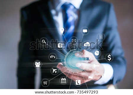 businessman working with modern devices,Internet of things - IOT and digital marketing via multi-channel communication network on mobile smart device application technology #735497293