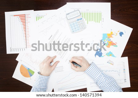 Businessman working with some financial data at the desk