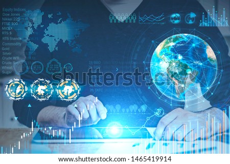 Businessman working with tablet in office with double exposure of business infographics interface. Stock market and future concept. Toned image. Elements of this image furnished by NASA #1465419914